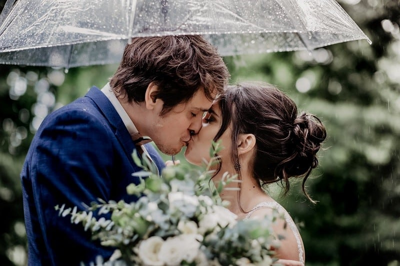 couple kiss wedding