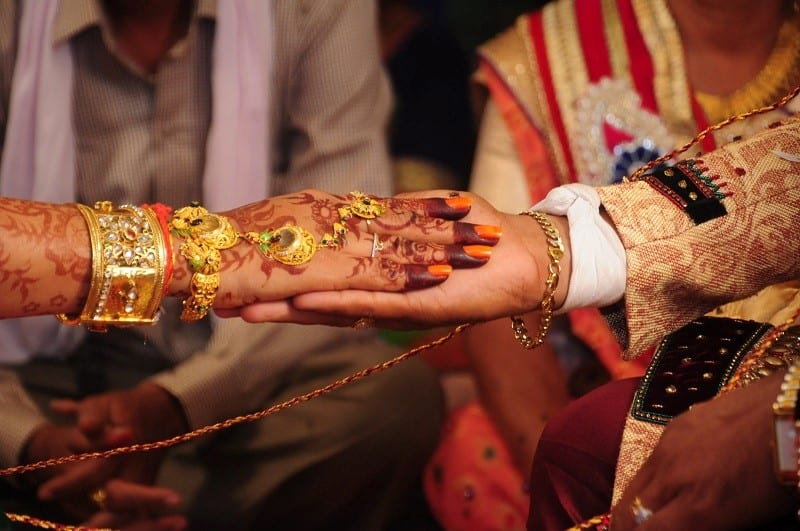holding hands couple indian
