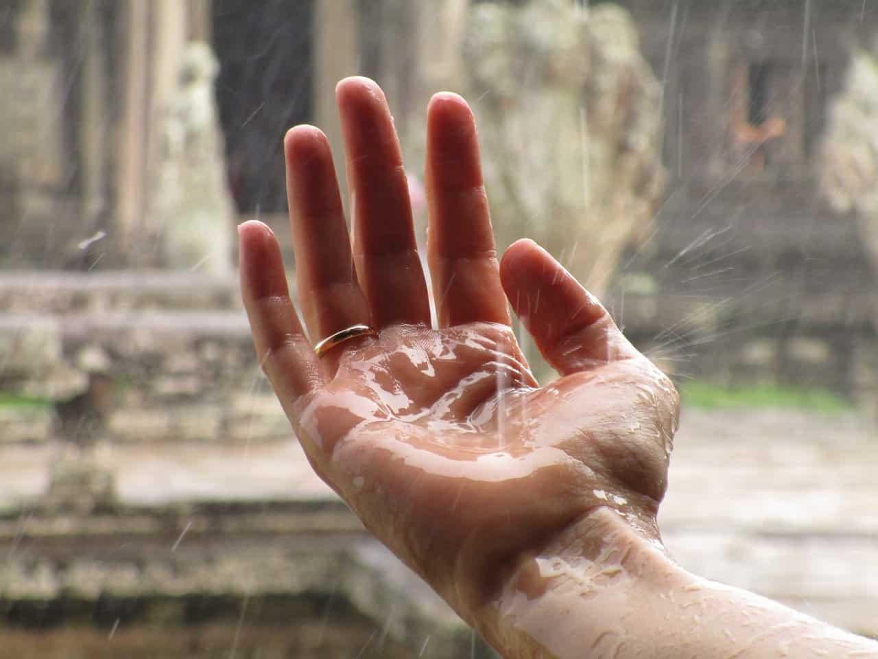 rainy wedding hand