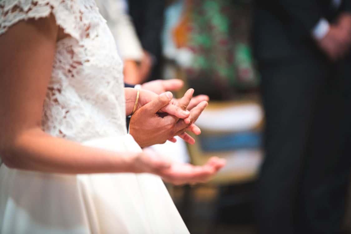 groom bride praying