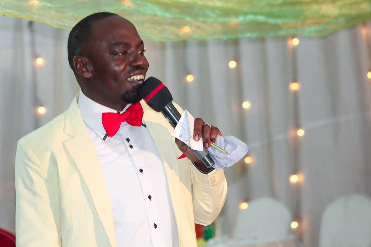 man speaking microphone