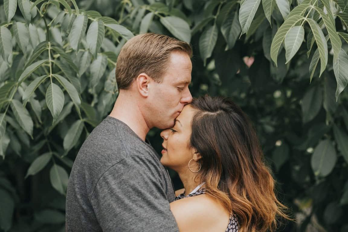 man kissing forehead