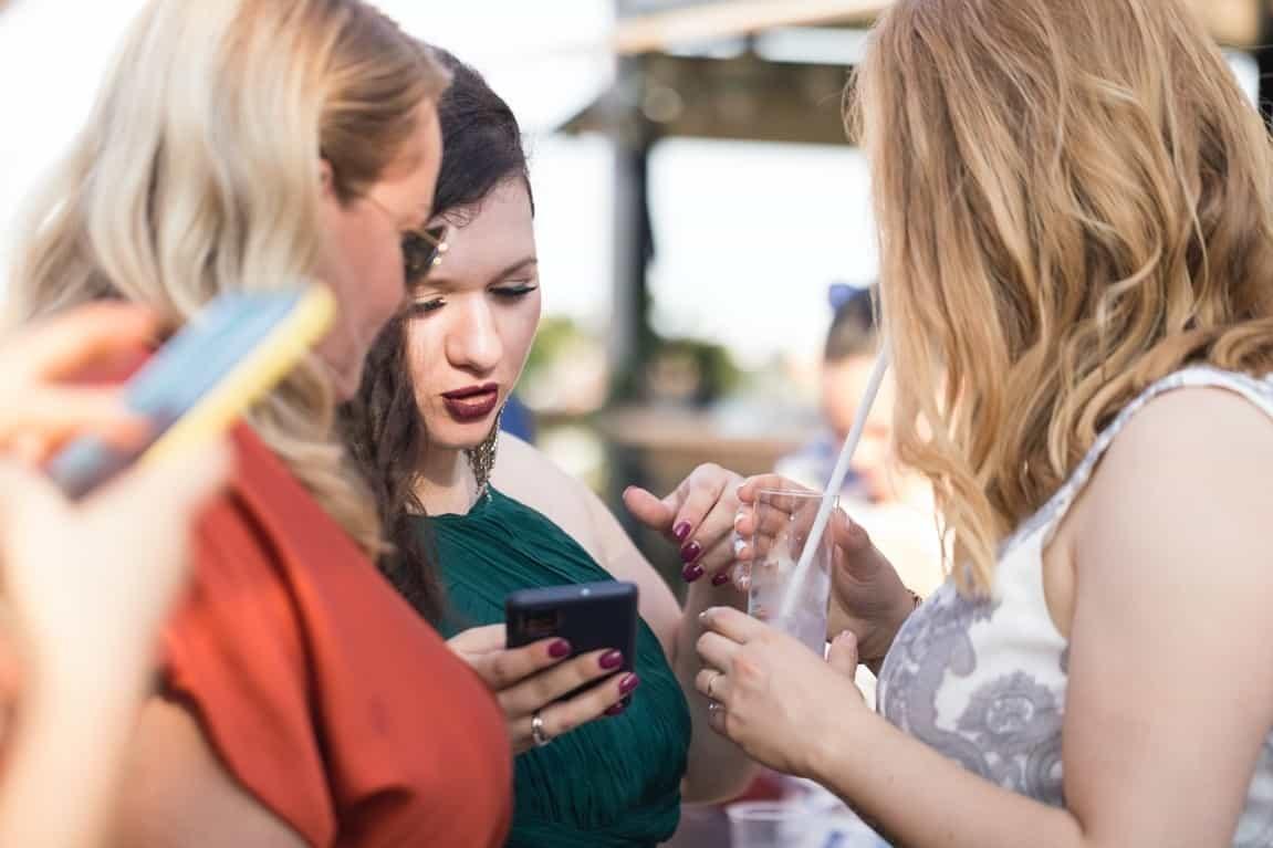 women checking phones
